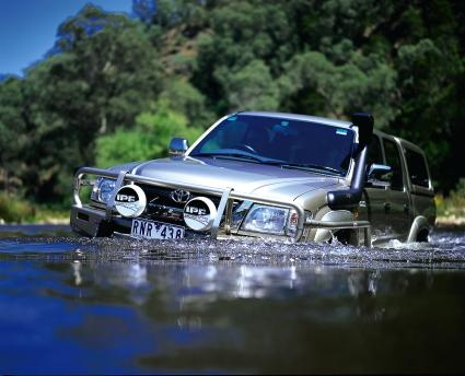 Offroad 4x4 fording in river